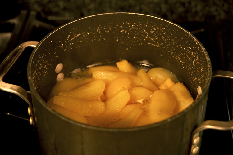 simmering fruit in a pot